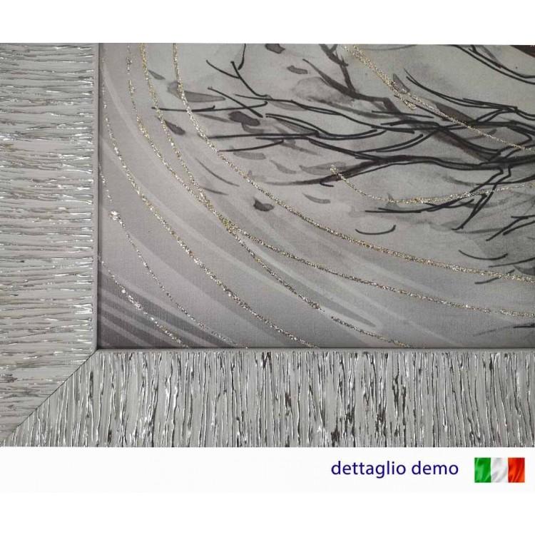 Dettaglio quadro in tela con glitter cornice